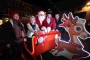 Romsey Round Table's new Santa sleigh in Romsey Market Place with Gail Suddaby, Brooke Suddaby, Cheryl Rickman and Round Table's Brian Stickley  Picture by Rachel Adams                           Order no: 22397013