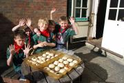 Copythorne Zulu Cubs with the rolls they baked for a charity dinner