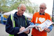(L-R): Pete Mitchell from Black Dam signs the petition watched by 38 Degrees member Eric Rivron.