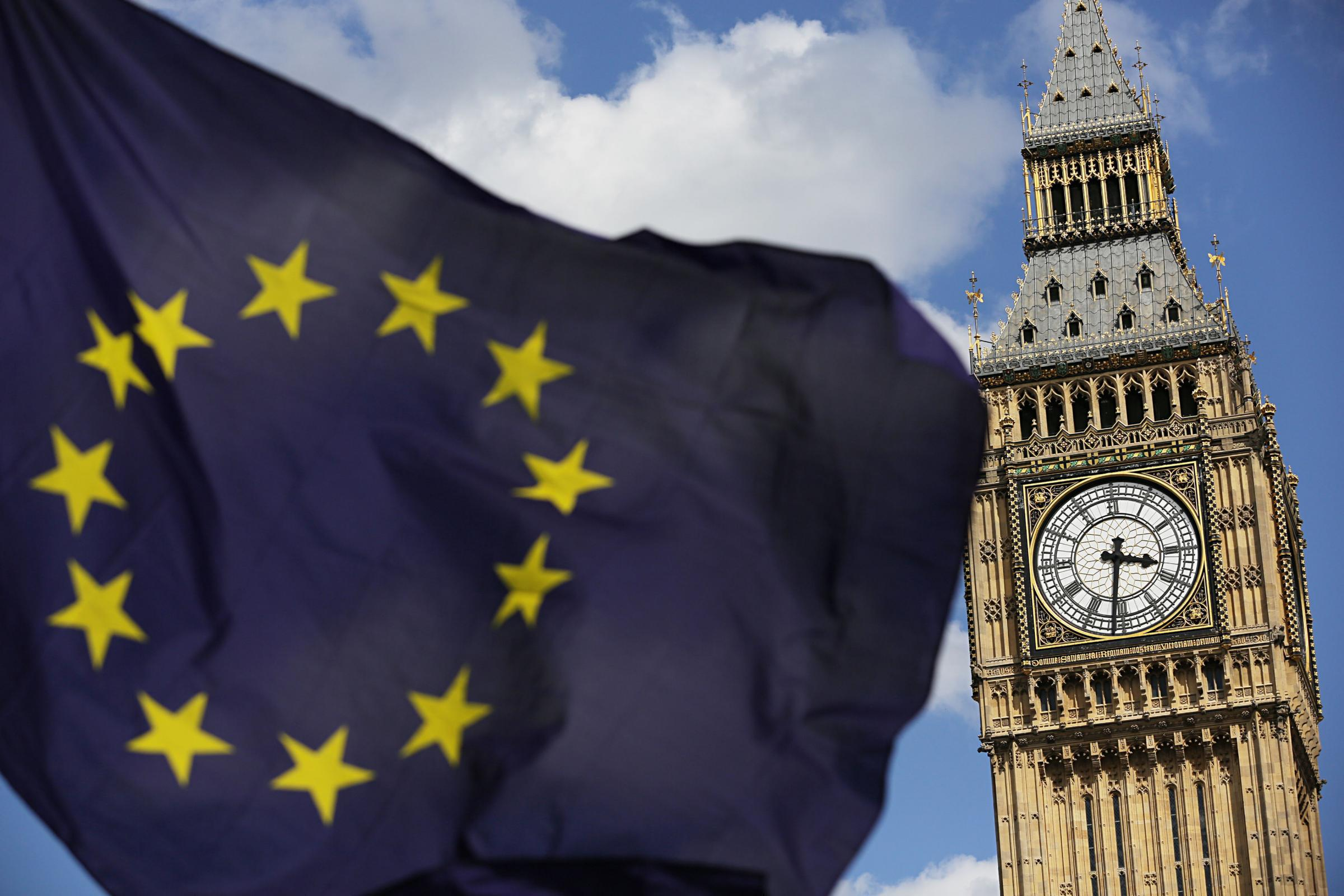 File photo dated 02/07/16 of a European Union flag in front of Elizabeth Tower. Big Ben should bong Britain out of the European Union on the day of Brexit, Leave-backing Tory MPs have said..