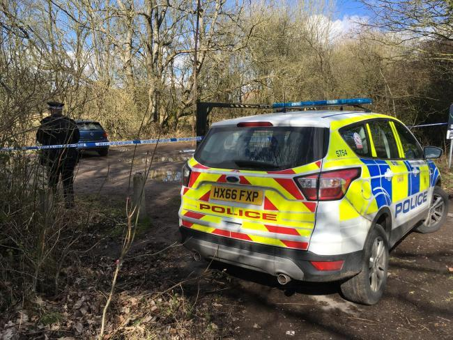 Police at the car park off the A3057, where Ms Cutbill's body was found