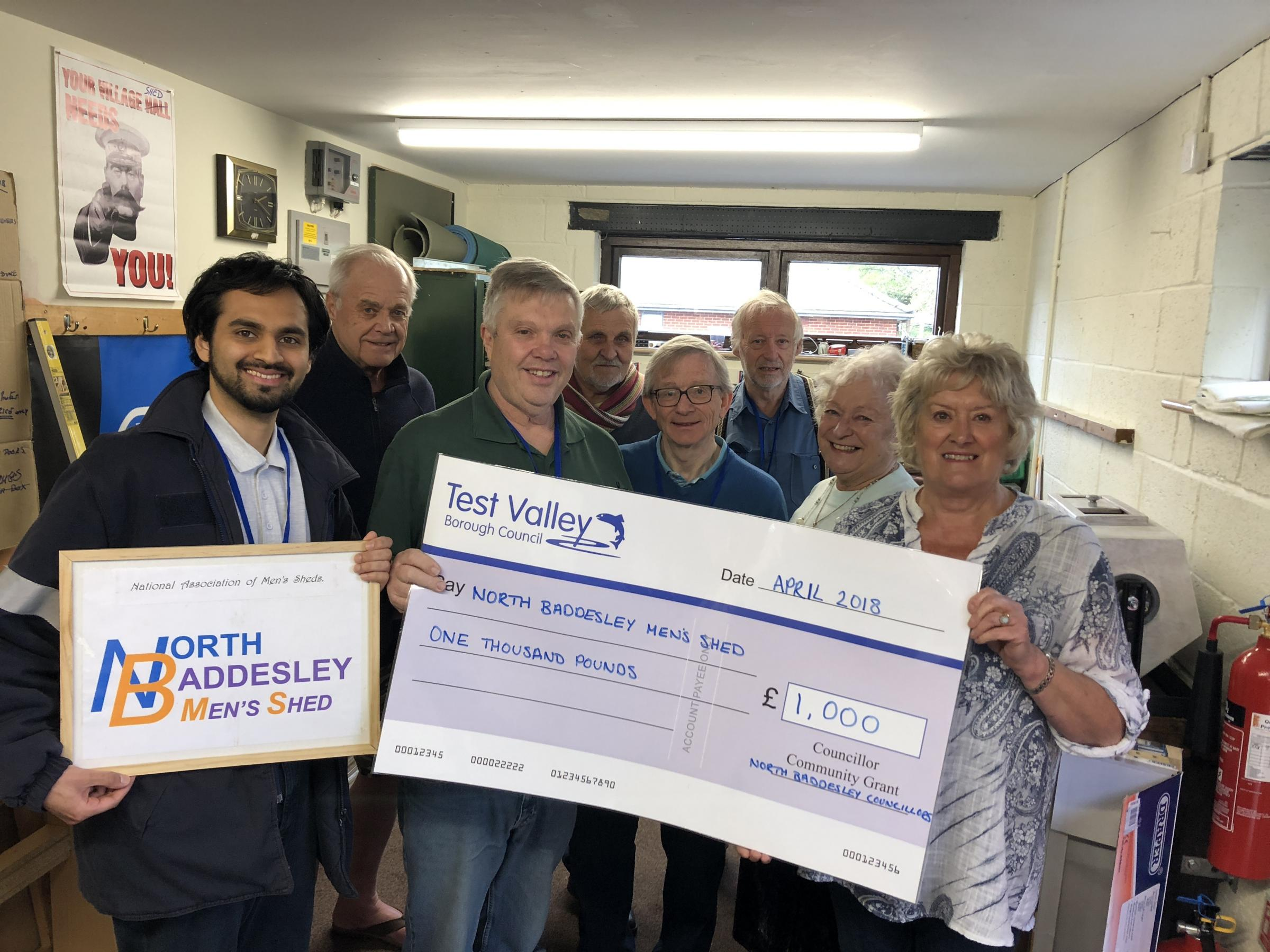 Members of North Baddesley Men's Shed are presented with the grant by councillors Ann Tupper and Celia Dowden