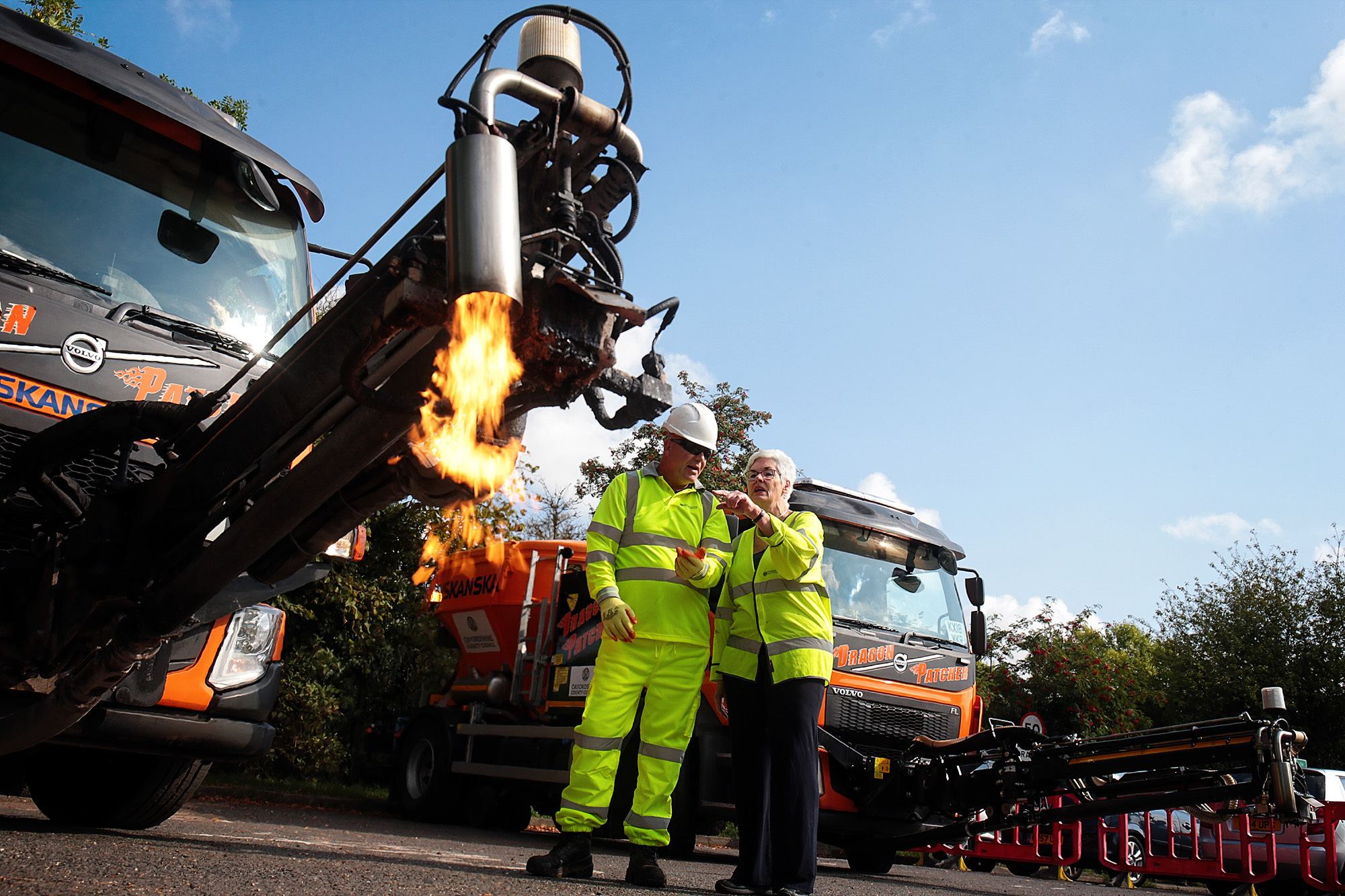 Dragon Patcher Tim Harris explains the mysteries of his new machine to Yvonne Constance, cabinet member with responsibility for the environment, as the County Council unveiled it's latest Dragon Patcher which will be used to repair potholes in the cou