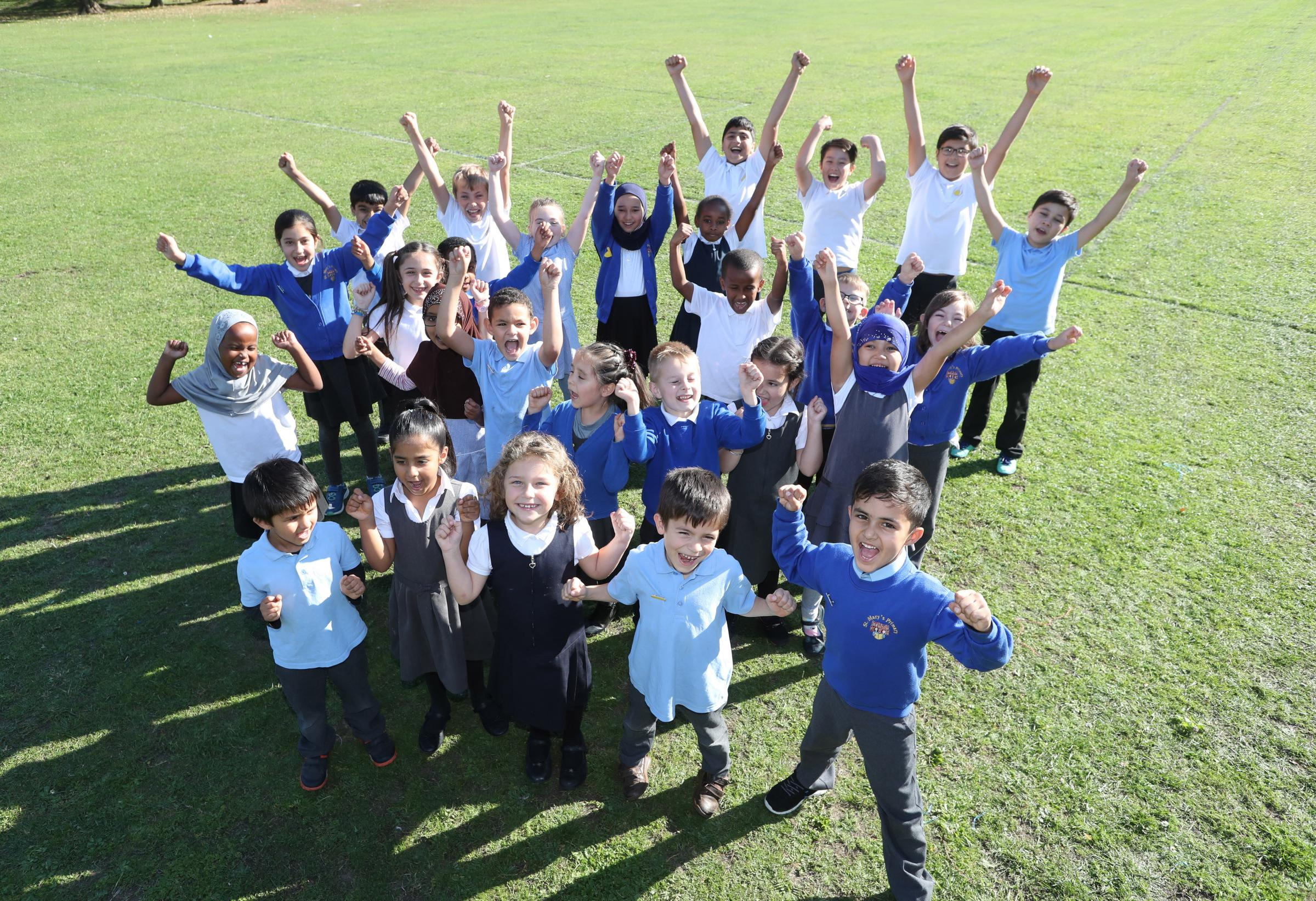 School report at St Mary's Primary School - School councillors and prefects pictured on the school's playing fields.