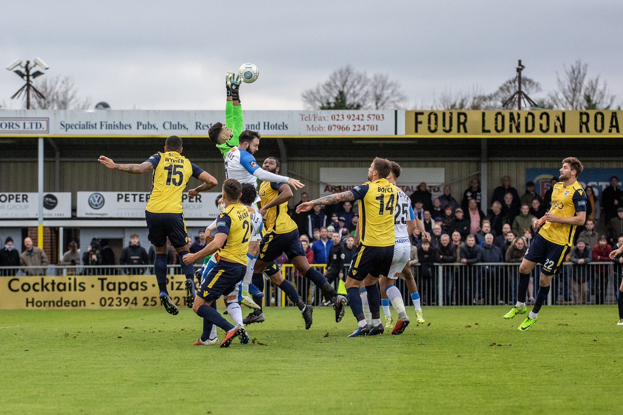 Eastleigh (yellow/black) on defensive duties at Havant last week. Photo: Graham Scambler.