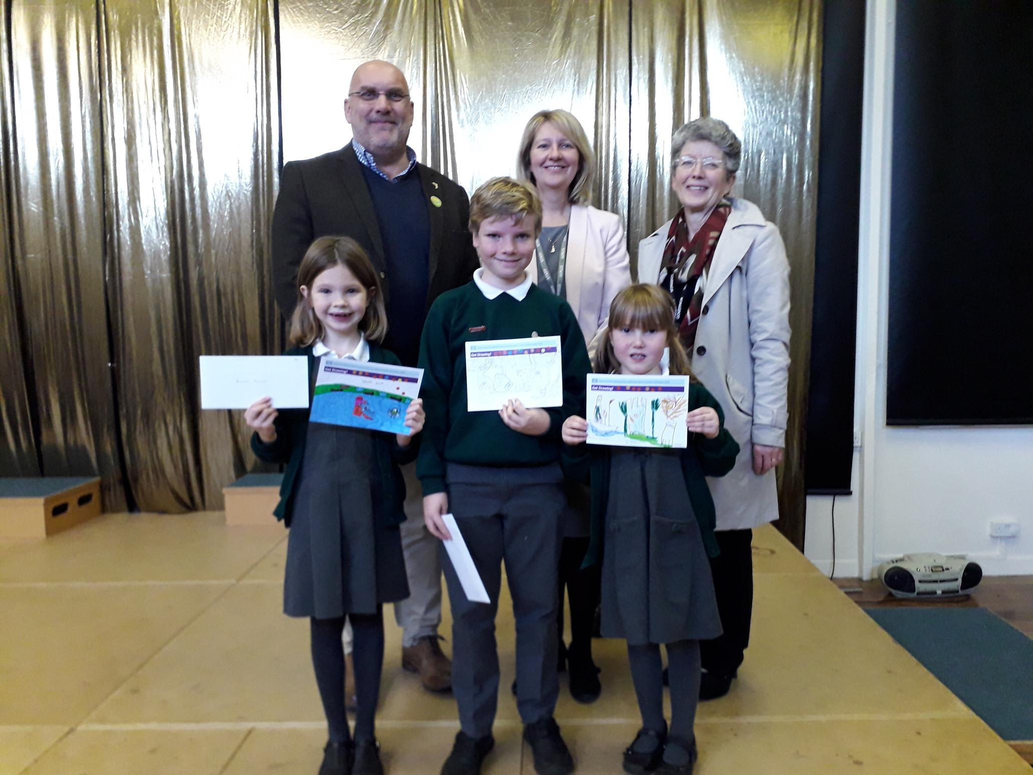 Chair of Romsey Future, councillor Nick Adams-King alongside head teacher Julie-Anne Palfrey and chair of governors, Liz Wagner with winner Annabel Blencowe (left), Toby Davies and Hadleigh Auger.
