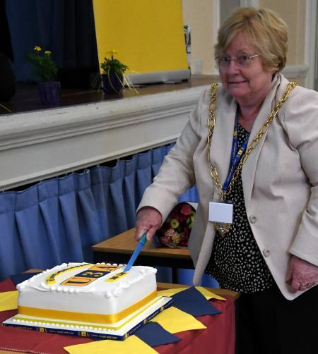 Cllr Dorothy Baverstock cutting the cake at Romsey & District U3A 20th Anniversary afternoon tea